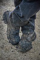 Asphalt worker's boots.