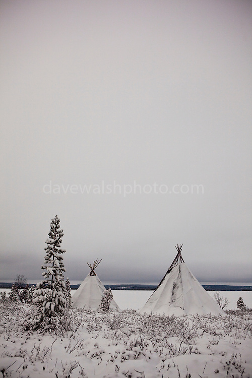 "Two traditional Saami tents, or Lavvu - typical of reindeer herding peoples - on the shore of the frozen lake Muddusjarvi, near Inari, Lapland, Finland. Taken at 3am with some moonlight, 30"" exposure, December 2011."