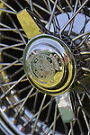 Westbury, New York, USA. June 12, 2016. Rudge-Whitworth, Milano, 52mm 72 spoke chrome wire wheel with 2-bar spinner (AKA knock off), with Destro Smontare printed, is seen in close up on 1973 Intermeccanica Squire SS-100 Italian luxury classic roadster, owned by Mark Offenberg of Valley Stream, which won 3rd Place Trophy in the foreign car category at the Antique and Collectible Auto Show at the 50th Annual Spring Meet at Old Westbury Gardens, in the Gold Coast of Long Island, and sponsored by Greater New York Region, GNYR, Antique Automobile Club of America, AACA. Car is the 46th of only 50 Intermeccanica's coachbuilt in Turin, Italy.