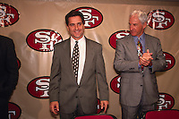 SANTA CLARA, CA - New head coach Steve Mariucci of the San Francisco 49ers is introduced to the media with former head coach George Seifert (right) at the 49ers facility in Santa Clara, California in 1997. Photo by Brad Mangin