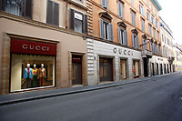 Gucci's store closed in a desert Via Condotti<br /> Rome March 12th 2020. Rome the day after the last Coronavirus decree, that increase the restrictions of the march 9th decree. All the shops, bars, restaurants and pubs will have to stay close, apart for the ones of public utility as pharmacies, supermarkets and tobacco stores. People are requested to stay at home and go out just to buy food or medicines. In city centre, police officers warn the few tourists and passers to stay into the hotels or at home and to get out just to find food. <br /> Photo Samantha Zucchi Insidefoto