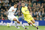 Real Madrid's Raphael Varane (l) and Villareal's Adrian Lopez during La Liga match. April 20,2016. (ALTERPHOTOS/Acero)