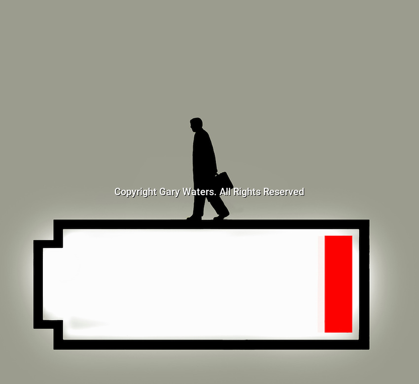Businessman walking on top of low battery symbol