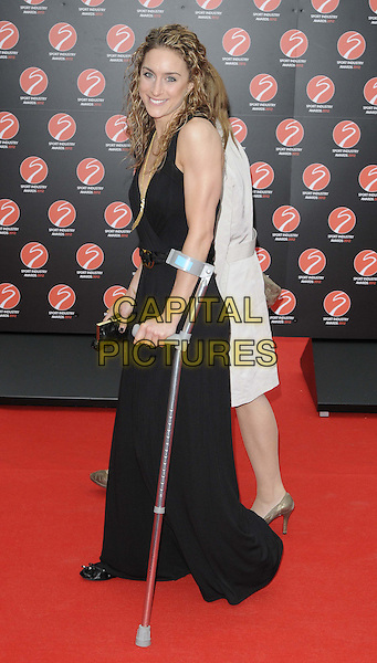 Amy Williams.The Sport Industry Awards 2012, Battersea Evolution, Battersea Park, London, England..May 2nd, 2012.full length black jumpsuit wide flared leg  clutch bag side crutches .CAP/CAN.©Can Nguyen/Capital Pictures.