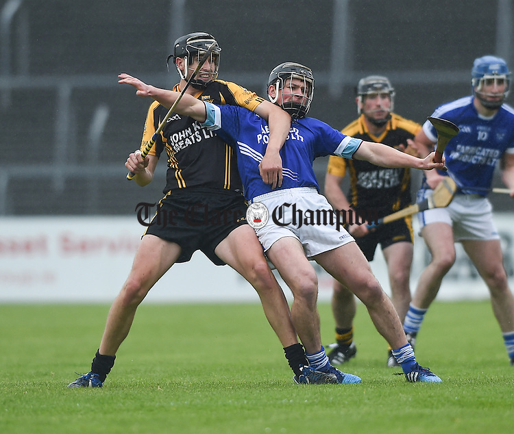 Damien Burke of Ballyea in action against Liam Markham of Cratloe during their match in Ennis. Photograph by John Kelly.
