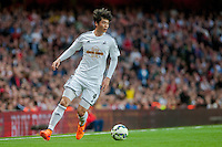 LONDON, ENGLAND - MAY 11 Ki Sung-Yueng of Swansea City  in action during  to the Premier League match between Arsenal and Swansea City at Emirates Stadium on May 11, 2015 in London, England.  (Photo by Athena Pictures/Getty Images)