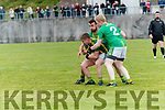 Lios Póil Sean Ó Nuanain tackled by Castlegregory Gavin O'Connor and James Galway during the West Kerry Championship game at Lios Póil GAA grounds on Saturday evening.