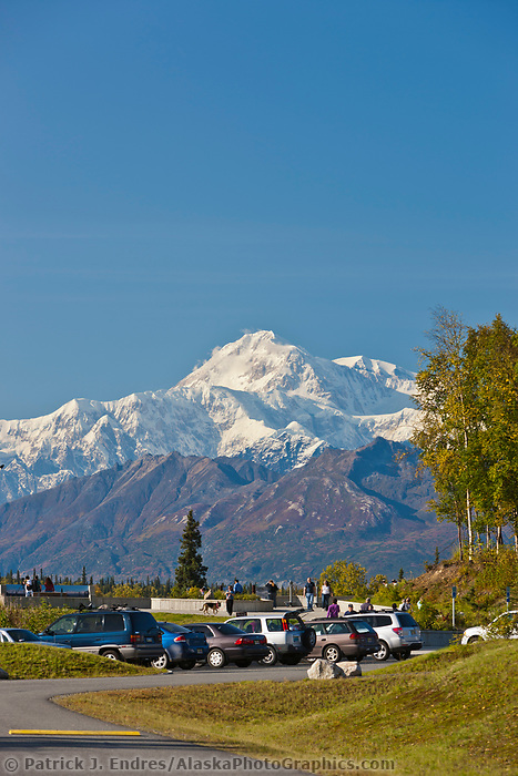 Tourists view Mt. Denali from viewpoint along the George Parks Highway.
