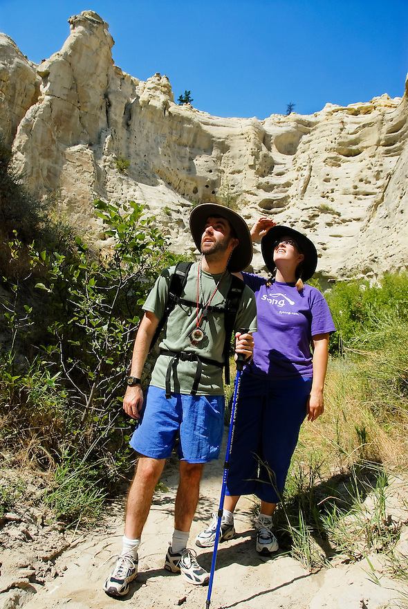 Two hikers explore Neat Coulee in the White Cliffs of the Missouri River, central Montana.