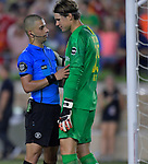 Football: Test Match, Liverpool FC - Borussia Dortmund. Referee Nima Saghafi (left) talks to Borussia Dortmund goalkeeper Marwin Hitz (35) before Liverpool took a penalty kick on Hitz in their exhibition match on July 19, 2019 at Notre Dame Stadium. <br /> Tim Vizer/DPA