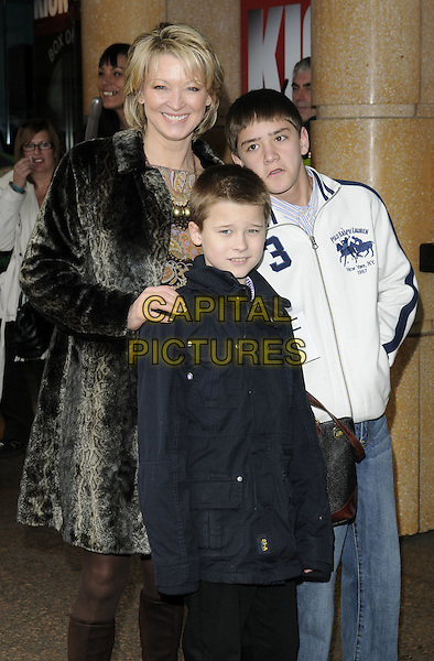 "GILLIAN TAYLFORTH.At the ""How To Train Your Dragon"" VIP gala screening, Vue West End cinema, Leicester Square, London, England, UK, 28th March 2010..half length family sons children kids grey gray fur coat  .CAP/CAN.©Can Nguyen/Capital Pictures"