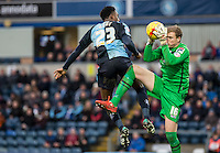 Goalkeeper Elliot Justham of Luton Town saves from Gozie Ugwu of Wycombe Wanderers during the Sky Bet League 2 match between Wycombe Wanderers and Luton Town at Adams Park, High Wycombe, England on 6 February 2016. Photo by Andy Rowland.