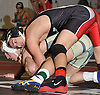 Jesse Dellavecchia of East Islip, top, battles Brett Brice of Longwood at 132 pounds during the Suffolk County varsity wrestling Division I semifinals at Hofstra University on Sunday, February 15, 2015. Dellavecchia won the match by major decision.<br /> <br /> James Escher