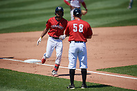 Erie SeaWolves manager Mike Rabelo (58) congratulates Jose Azocar (24) after a home run during an Eastern League game against the Harrisburg Senators on June 30, 2019 at UPMC Park in Erie, Pennsylvania.  Erie defeated Harrisburg 4-2.  (Mike Janes/Four Seam Images)