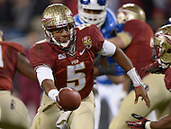 December 7, 2013  (Charlotte, North Carolina)  Florida State Seminoles quarterback Jameis Winston #5 hands the ball to Florida State Seminoles running back Devonta Freeman #8 during the 2013 ACC Championship game against the Duke Blue Devils. (Photo by Don Baxter/Media Images International)
