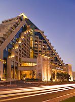 Dubai.  Raffles Hotel built on an Egyptian theme and adjacent to the Wafi Mall, a luxurious shopping centre/center.  Evening.........