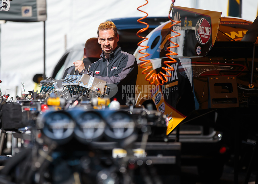 Feb 11, 2019; Pomona, CA, USA; Crew member for NHRA funny car driver J.R. Todd during the Winternationals at Auto Club Raceway at Pomona. Mandatory Credit: Mark J. Rebilas-USA TODAY Sports