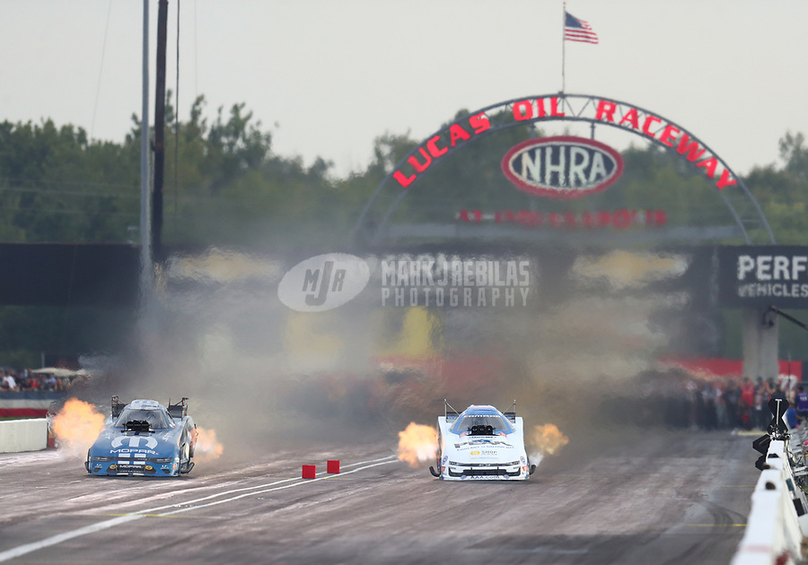 Aug 31, 2019; Clermont, IN, USA; NHRA funny car driver Matt Hagan (left) alongside John Fiorce during qualifying for the US Nationals at Lucas Oil Raceway. Mandatory Credit: Mark J. Rebilas-USA TODAY Sports