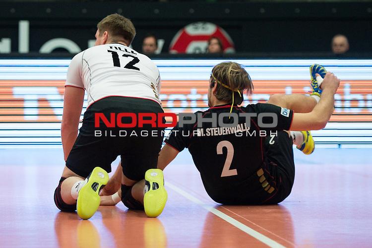 29.12.2013, Lotto Dome, Maaseik<br /> Volleyball, Belgien vs. Deutschland<br /> <br /> Markus Steuerwald (#12 GER), Ferdinand Tille (#2 GER)<br /> <br />   Foto &copy; nordphoto / Kurth