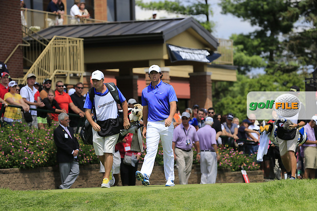 Rory McIlroy (NIR) and caddy J.P.Fitzgerald walk off the 1st tee to start his match during Sunday's Final Round of the 2013 Bridgestone Invitational WGC tournament held at the Firestone Country Club, Akron, Ohio. 4th August 2013.<br /> Picture: Eoin Clarke www.golffile.ie