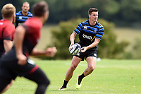 Freddie Burns passes the ball against the visiting Dragons team. Bath Rugby pre-season training on August 8, 2018 at Farleigh House in Bath, England. Photo by: Patrick Khachfe / Onside Images