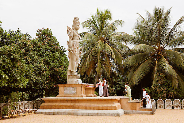 Sri Lankan Buddhists pray at an 18 foot statue of Bodhisattva Avalokitesvara at  the Kelaniya Temple in Kelaniya, Sri Lanka. The Kelaniya Raja Maha Vihara or Kelaniya Temple is a Buddhist temple in Kelaniya, Sri Lanka, seven miles from Colombo. The spot on which this temple stands derived its sanctity in the Buddhist era 2531, with the third visit of the Buddha to this country.Over 70 percent of Sri Lanka's population practices Buddhism.