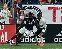 FOXBOROUGH, MA - JUNE 27: Cristian Penilla #70 dribbles as Raymon Gaddis #28 defends during a game between Philadelphia Union and New England Revolution at Gillette Stadium on June 27, 2019 in Foxborough, Massachusetts.