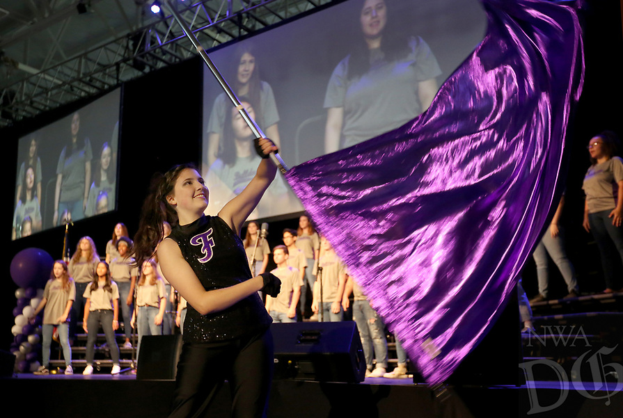 NWA Democrat-Gazette/DAVID GOTTSCHALK Gracie Dirkach, a junior and member of the Fayetteville High School Color Guard, performs Wednesday, August 7, 2019, during the Fayetteville Public Schools annual Convocation ceremony in Bulldog Arena on the Fayetteville High School campus. The event, which features performances by students, informational presentations and awards, serves as a kickoff to the school year which begins Tuesday in Fayetteville.