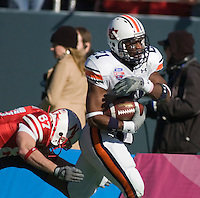 01 January 2007: Auburn defender Karibi Dede (#21) returns an interception past Nebraska receiver Nate Swift (#87) during the 2007 AT&T Cotton Bowl Classic between The University of Auburn and The University of Nebraska at The Cotton Bowl in Dallas, TX.