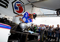 May 18, 2014; Commerce, GA, USA; NHRA top fuel driver Antron Brown fuels his dragster in the pits during the Southern Nationals at Atlanta Dragway. Mandatory Credit: Mark J. Rebilas-USA TODAY Sports