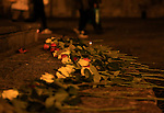 Roses are seen on November 15, 2015 at a makeshift memorial in Trento, North Italy, for the victims of November 13 attacks in Paris. <br /> Islamic State jihadists claimed a series of coordinated attacks by gunmen and suicide bombers in Paris that killed at least 132 people in scenes of carnage at a concert hall, restaurants and the national stadium.