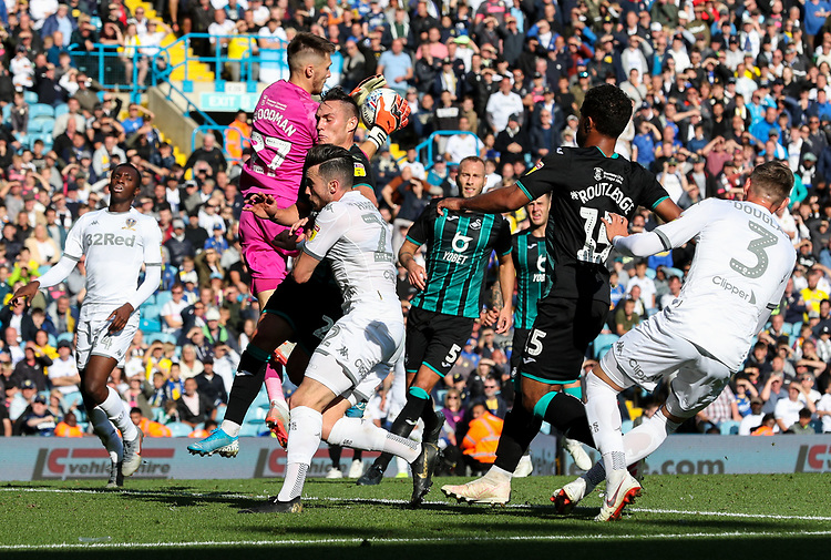 Swansea City's Freddie Woodman claims a cross ahead of Leeds United's Jack Harrison<br /> <br /> Photographer Alex Dodd/CameraSport<br /> <br /> The EFL Sky Bet Championship - Leeds United v Swansea City - Saturday 31st August 2019 - Elland Road - Leeds<br /> <br /> World Copyright © 2019 CameraSport. All rights reserved. 43 Linden Ave. Countesthorpe. Leicester. England. LE8 5PG - Tel: +44 (0) 116 277 4147 - admin@camerasport.com - www.camerasport.com