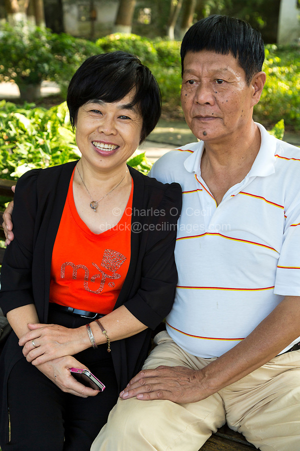 Wenzhou, Zhejiang, China.  Jiangxin Island.  Middle-aged Couple Sitting in the Park on a Pleasant Afternoon.