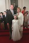 Laura, Seamus and Deirdre King at the First Holy Communion in Walshestown...Photo NEWSFILE/Jenny Matthews.(Photo credit should read Jenny Matthews/NEWSFILE)....This Picture has been sent you under the condtions enclosed by:.Newsfile Ltd..The Studio,.Millmount Abbey,.Drogheda,.Co Meath..Ireland..Tel: +353(0)41-9871240.Fax: +353(0)41-9871260.GSM: +353(0)86-2500958.email: pictures@newsfile.ie.www.newsfile.ie.FTP: 193.120.102.198.