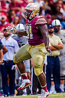 TALLAHASSEE, FLA 9/10/16-Florida State's Derrick Nnadi celebrates sacking Charleston Southern quarterback Robert Mitchell for six yards during second quarter action Saturday at Doak Campbell Stadium in Tallahassee. <br /> COLIN HACKLEY PHOTO