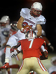 (Everett Ma 091914) Tewksbury 21, James Hirtle, makes the pass completion, Everett 7, Lukas Denis,  will help to bring Hirtle down, during the first quarter of the game, Friday, Sept. 19, 2014, at Everett Stadium. (Jim Michaud Photo) For Saturday