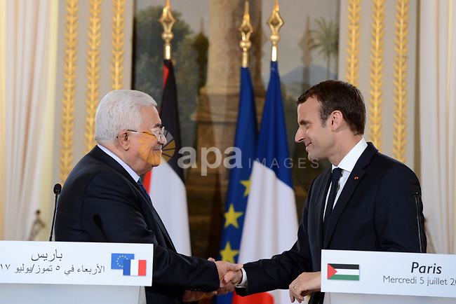 French President Emmanuel Macron shakes hands with Palestinian President Mahmoud Abbas, during a joint press conference following their meeting at the Elysee Palace in Paris, on July 5, 2017. Photo by Thaer Ganaim