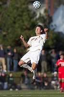 Boston College midfielder/defender Colin Murphy (21) heads the ball.  Rutgers University defeated Boston College in penalty kicks after two overtime periods in NCAA Division I tournament action, at Newton Campus Field, November 20, 2011.
