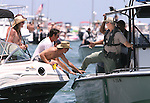 "Officers with the Florida Fish and Wildlife Commission checked boaters for safety equipment Memorial Day weekend at the White Trash Bash at Dog Island off the coast of Carrabelle Sunday May 27, 2007.  ""We just want them to be safe"" said Cpt Craig Duval, an area supervisor with the Commission.  Fourty law enforcement officers from four different agencies made 10 arrests for boating under the influence.    (Mark Wallheiser/TallahasseeStock.com)"