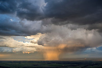 Rain shower at sunset. Pueblo County, Colorado. May 28, 2015