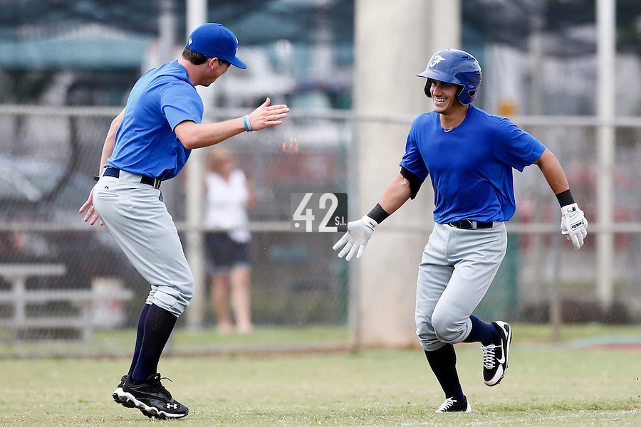 19 September 2012: Maxime Lefevre runs the bases and is congratulated by Jeff Stoeckel after hitting a home run during Team France friendly game won 6-3 against Palm Beach State College, during the 2012 World Baseball Classic Qualifier round, in Lake Worth, Florida, USA.