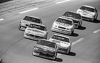 #94 Ford Thunderbird driven by Terry Labonte leads a pack of cars during the DieHard 500, NASCAR Winston Cup race, Talladega Superspeedway, July 26, 1992.  (Photo by Brian Cleary/bcpix.com)
