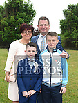 Ciarán Smith who received first holy communion in St Joseph's church Mell, pictured with parents Padraic and Karen and brother Evan. Photo:Colin Bell/pressphotos.ie