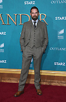 "HOLLYWOOD, CA - FEBRUARY 13: Duncan LaCroix, at the Premiere Of Starz's ""Outlander"" Season 5 at HHollywood Palladium in Hollywood California on February 13, 2020. Credit: Faye Sadou/MediaPunch"