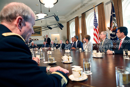 United States President Barack Obama meets with bipartisan Members of Congress in the Cabinet Room of the White House in Washington, D.C. on September 3, 2013. From left to right in foreground: Chairman of the Joint Chiefs of Staff General Martin Dempsey, U.S. Army;  U.S. Senator Bob Corker (Republican of Tennessee); U.S. Senator Robert Menendez (Democrat of New Jersey); U.S. Representative Steny Hoyer (Democrat of Maryland); U.S. Senator Richard J. Durbin (Democrat of Illinois); Ambassador Susan Rice, National Security Advisor; Speaker of the U.S. House John Boehner (Republican of Ohio); President Obama. <br /> U.S. House Democratic Leader Nancy Pelosi (Democrat of California); U.S. Senate Republican Leader Mitch McConnell (Republican of Kentucky); and  U.S. House Majority Leader Eric Cantor (Republican of Virginia).<br /> Credit: Dennis Brack / Pool via CNP
