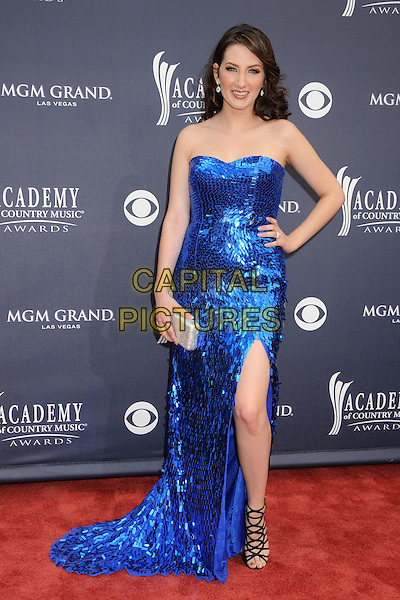 KATIE ARMIGER .46th Annual Academy of Country Music Awards - Arrivals held at the MGM Grand Garden Arena, Las Vegas, Nevada, USA, 3rd April 2011..full length dress hand on hip long maxi slit split  strappy sandals black strapless sequined sequin .CAP/ADM/BP.©Byron Purvis/AdMedia/Capital Pictures.