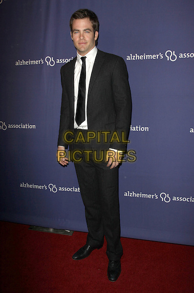 "CHRIS PINE .18Th Annual ""A Night at Sardi's"" Benefitting The Alzheimer's Association held At The Beverly Hilton Hotel, Beverly Hills, California, USA..March 18th, 2010.full length black suit  .CAP/ADM/KB.©Kevan Brooks/AdMedia/Capital Pictures."