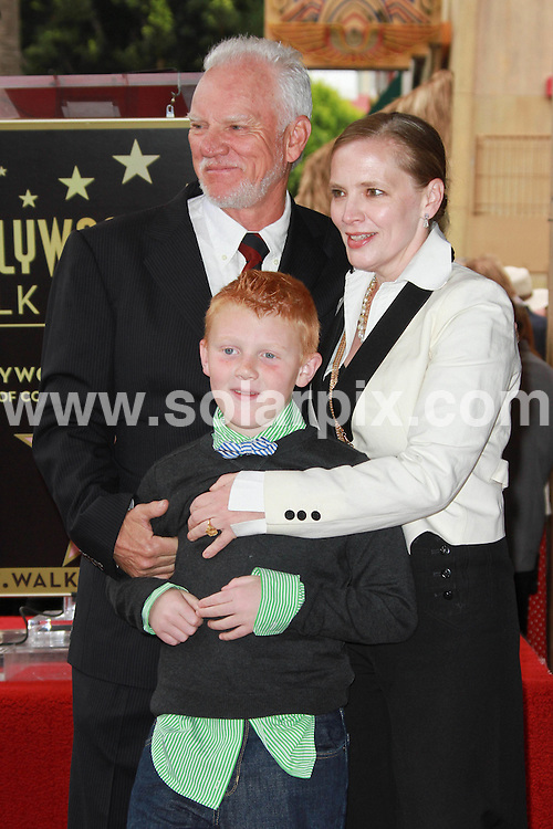**ALL ROUND PICTURES FROM SOLARPIX.COM**                                             **SYNDICATION RIGHTS FOR UK, AUSTRALIA, DENMARK, PORTUGAL, S. AFRICA, SPAIN & DUBAI (U.A.E) & ASIA (EXCLUDING JAPAN) ONLY**                                                                                  Malcolm McDowell Honoured with a Star on the Hollywood Walk of Fame on March 16, 2012, Hollywood, CA, USA.                                                                     This pic:    Malcolm McDowell, wife Kelley McDowell and son Beckett McDowell                                                                                    .JOB REF:    14576    PHZ Evans       DATE:  17.03.12                                                          **MUST CREDIT SOLARPIX.COM OR DOUBLE FEE WILL BE CHARGED**                                                                      **MUST AGREE FEE BEFORE ONLINE USAGE**                               **CALL US ON: +34 952 811 768 or LOW RATE FROM UK 0844 617 7637**