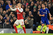 10th January 2018, Stamford Bridge, London, England; Carabao Cup football, semi final, 1st leg, Chelsea versus Arsenal; Jack Wilshere of Arsenal reacts to a refereeing decision