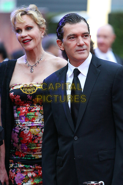 Melanie Griffith & Anotnio Banderas.Children's Hospital Los Angeles Gala: Noche de Ninos, Los Angeles, California, USA, 20th October 2012..half length strapless floral print red pink black dress necklace scarf over shoulder  suit tie husband wife couple married .CAP/ADM/PH.©Paul A. Hebert/AdMedia/Capital Pictures.